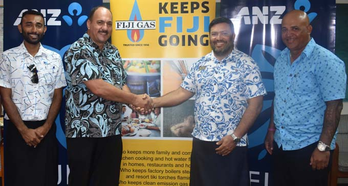 Committee member Christopher Chand, Trustee Craig Powell, Fiji Gas CEO Hans Reiher and Fiji Gas West manager David Aitcheson at the Tourism Fiji office in Namaka yesterday. Photo: WAISEA NASOKIA